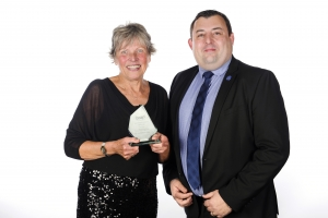 Unsung Hero of the year, Denise Knibbs with Ian Seabrook from category sponsors  More Leisure at Stoke Mandeville Stadium.