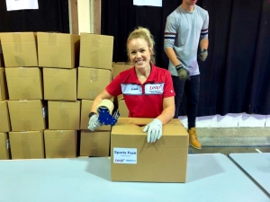 Leap team member Wendy Couzin, packing boxes ready for distribution.